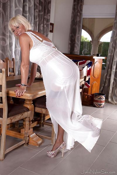 Mature stocking and nylon model Jan Burton posing topless in garters