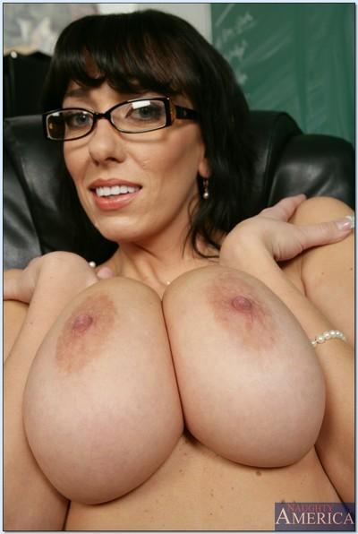 Mature teacher in glasses Alia Janine denudes her curvy assets