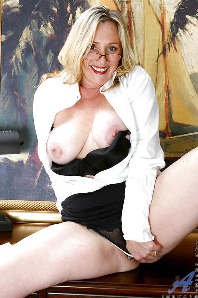 Blond secretary in glasses revealing her mature pussy from black pantyhose
