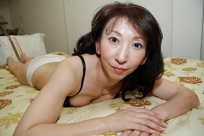 Asian housewife Mako Shinozuka takes a hot shower while all alone