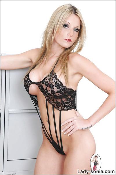 Seductive blonde MILF with sexy legs posing in erotic lingerie