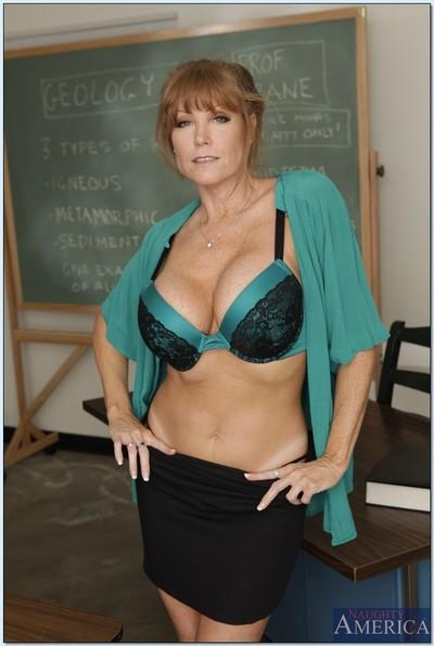 Mature teacher Darla Crane shows big tits and hot ass stripping skirt