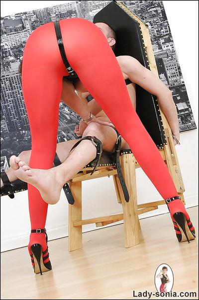 Lustful mature femdom in pantyhose playing wth her bound male pet
