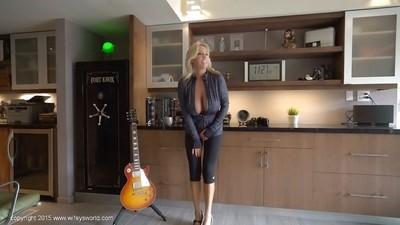 Chesty mature woman Sandra Otterson letting massive natural tits loose