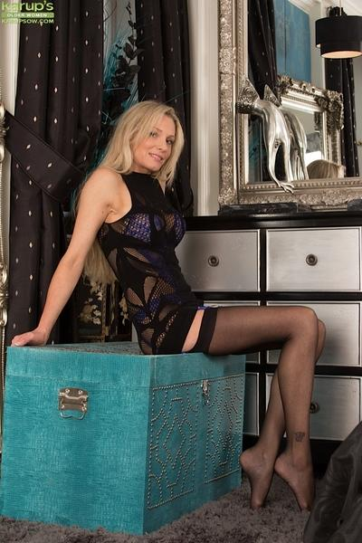 Blonde mature Angel P. shows off her perfect legs in stockings