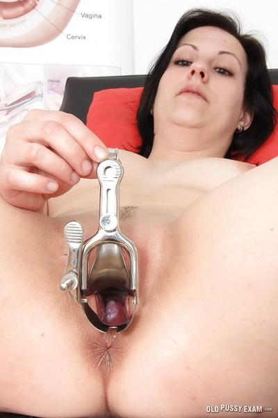 Mature woman Lydie gets naked for speculum insertion at doctor