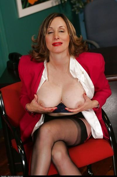 Gorgeous foot fetish mature babe Abigail Fraser revealing her big tits