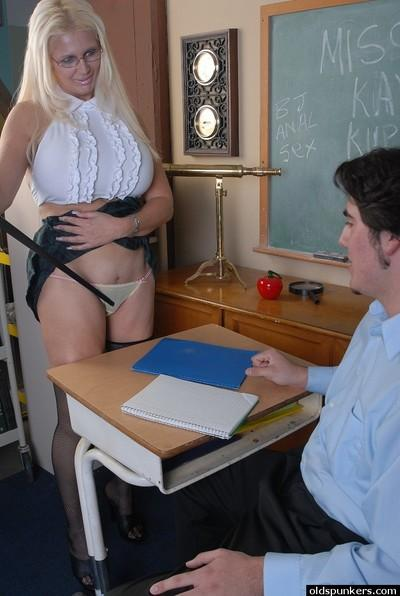 Bosomy older blonde teacher Kayla Kupcakes taking student