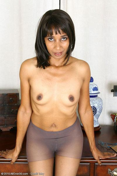 Mature ebony secretary slowly strips in the office and teases in black pantyhose.