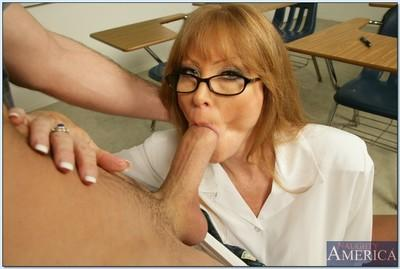 Sexy mature in glasses Darla Crane seducing her student for steamy sex