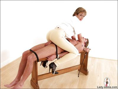 Fully clothed femdom on high heels has some fun with her male pet