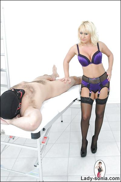 Lustful mature femdom in lingerie gives a great blowjob to her man slave