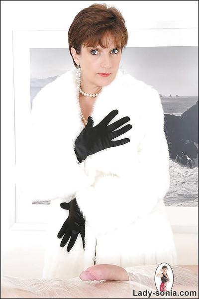 Mature fetish lady in velvet gloves teasing her male pet