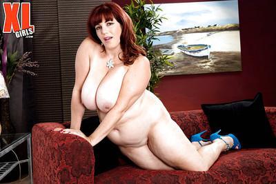 Thick older redhead Roxee Robinson baring huge boobs before masturbating