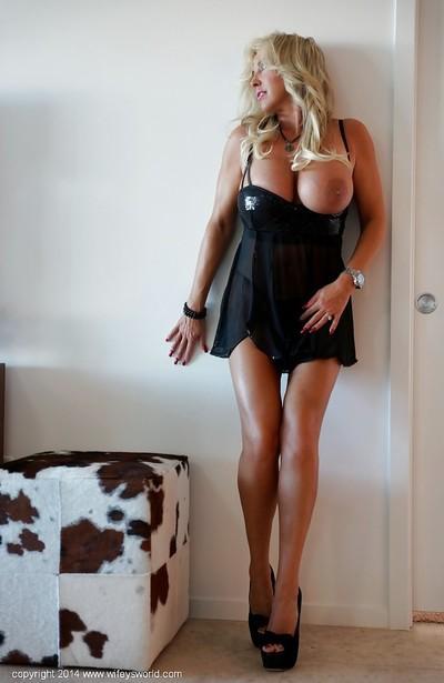 Slender tanned blonde Sandra Otterson is undressing pretty slowly