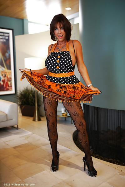 Buxom housewife Sandra Otterson modelling sexy crotchless bodystocking