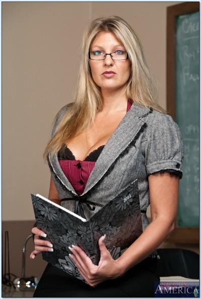 Blonde mature teacher with glasses Jezebel Jones teases in lingerie.
