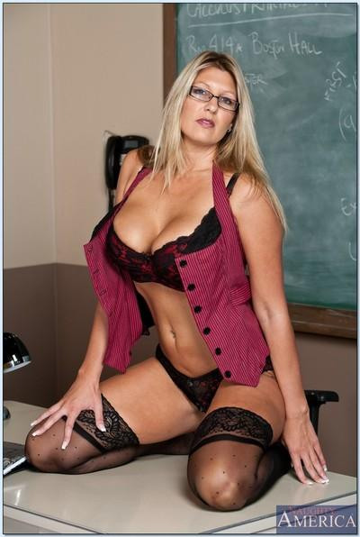 Blonde mature teacher with glasses Jezebel Jones teases in lingerie.