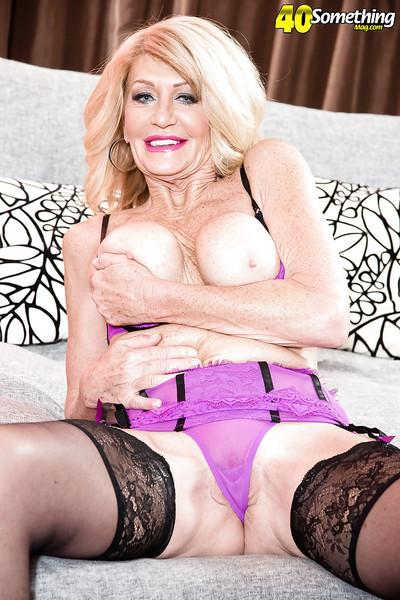 Aged blonde babe Kendall Rex baring big tits in stockings and high heels