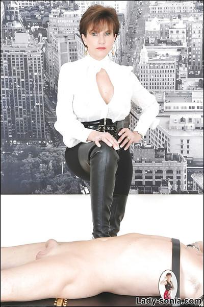 Seductive mature femdom jerks and sucks off her bound male pet