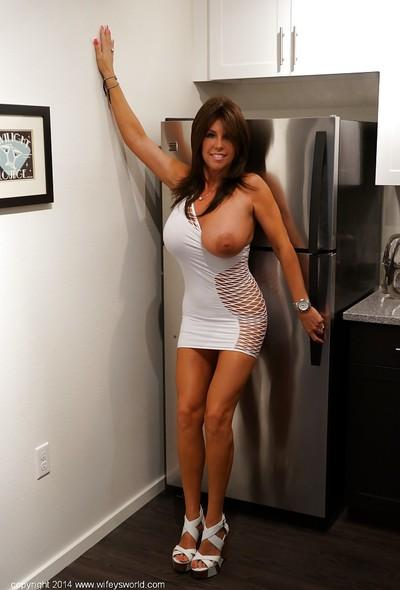 Posing scene features mature housewife with big tits Sandra Otterson