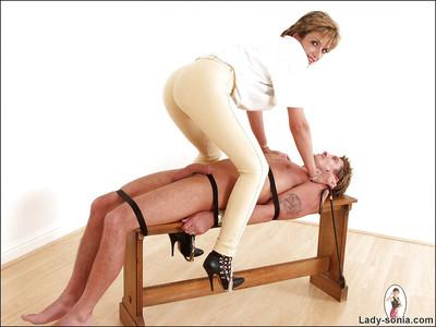 Mature femdom with sexy legs face sitting and torturing her manslave
