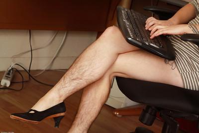 Mature redhead secretary Velma displays her hairy everything at work