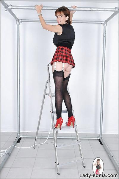 Seductive mature lady in black nylon stockings doing upskirt