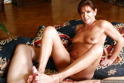 Mature European broad Lady Sarah face sitting man while jerking cock