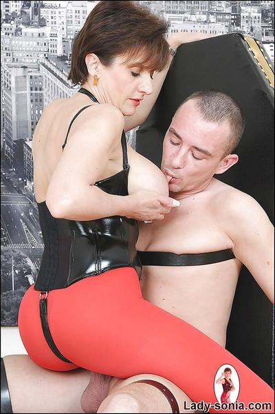 Horny femdom in red pantyhose playing with her bound boyslave