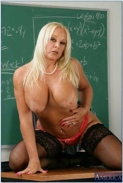 Mature fatty teacher Alexis Golden posing in high heels and lingerie.