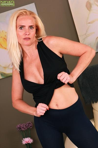 Aged Euro blonde Sevikova revealing nice older woman boobs while undressing