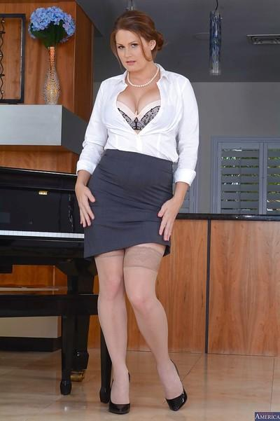 Mature teacher Allison Moore reveals her natural big tits in a skirt
