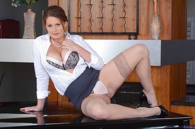 Mature teacher Allison Moore reveals her natural big tits in a skirt