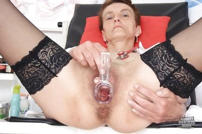 Granny Rozi shows us all the things she can shove into her pussy