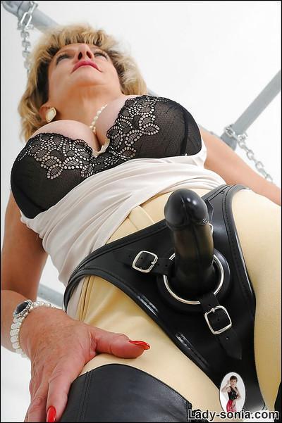 Mature cutie Lady Sonia reveals her big tits in a fetish scene