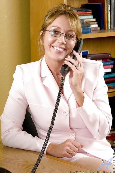 Mature office secretary Samantha Stone stripping to white stockings