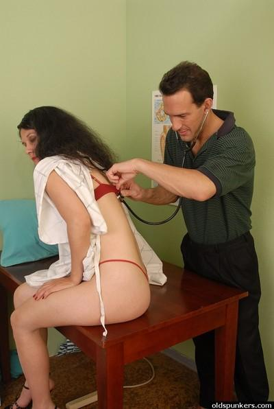 Older brunette patient Carmen having shaved vagina examined by doctor