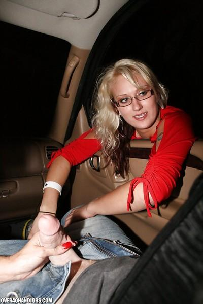 Lascivious mature blonde gives a sensual handjob in the car