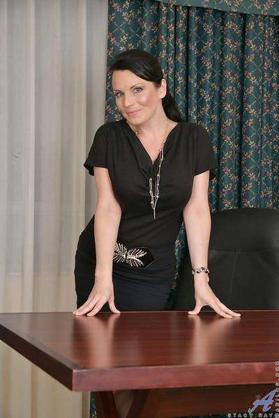 Older office babe Stacy Ray stripping down to nylons and garters