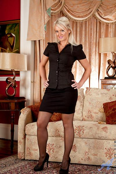 Mature blonde vixen in openwork stockings gets rid of her clothes