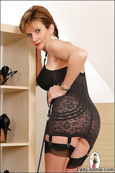 Fuckable mature lady posing in black stockings and lingerie