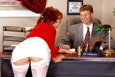Busty stocking clad aged redhead secretary Cherry Brady giving bj in office