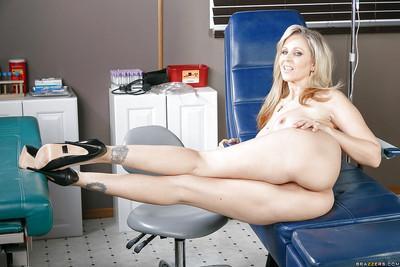 Busty blonde nurse Julia Ann lets her big natural juggs loose at work
