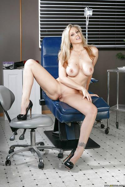 Busty blonde nurse Julia Ann lets her big natural juggs loose at work