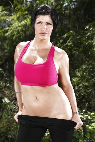 Full-figured mature brunette Shay Fox stripping off her sport outfit