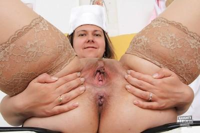 Mature nurse Iva Wild spreads fat cunt and inserts medical device