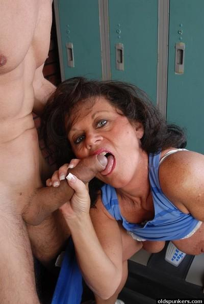 Aged brunette Debella taking cumshot on face after giving bj in weight room