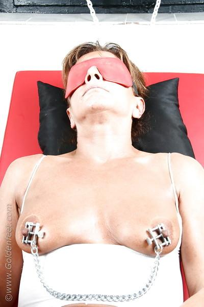 Older solo BDSM model lady Sarah taking cumshot on tortured nipples