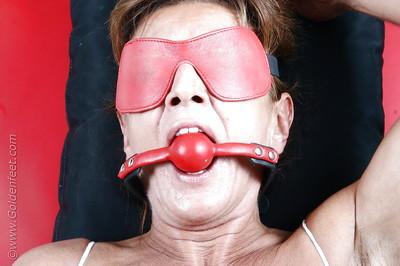 Older solo BDSM model lady Sarah taking cumshot on tortured nipples